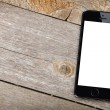 Smart phone on wooden table — Stock Photo