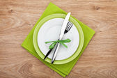 Fork with knife over plates — Stock Photo