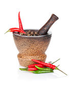 Mortar and pestle with red hot chili pepper and peppercorn — Stock Photo