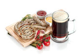 Grilled sausages with ketchup, mustard and mug of beer — ストック写真