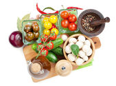 Fresh ingredients for cooking: tomato, cucumber, mushroom and spices — Stock Photo
