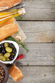 Italian food appetizer of olives, bread, olive oil and balsamic vinegar — Stock Photo