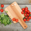 Cherry tomatoes on wooden table — Stock Photo #43167571