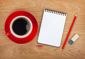 Notepad with office supplies and coffee — Stock Photo