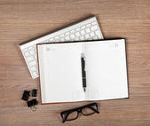 Blank notepad with pen and glasses — Stock Photo