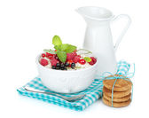 Fresh corn flakes with berries and milk jug — Foto de Stock