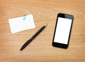 Business cards, pen and mobile phone — Stock fotografie