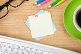 Blank post-it with office supplies and cup — Stock Photo