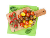 Cherry tomatoes on cutting board — Stock Photo
