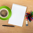 Blank notepad with office supplies and green coffee cup — Stock Photo
