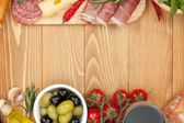 Red wine with cheese, olives, tomatoes — Stock Photo