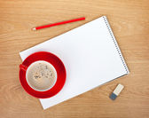 Blank notepad with office supplies and  coffee cup — Stock Photo