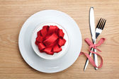 Valentine's day gift box on plate and silverware — Stock Photo