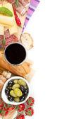 Red wine with cheese, prosciutto, bread — Stock Photo