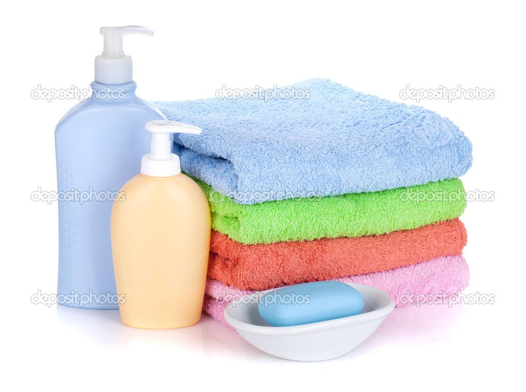Gekleurde handdoeken bij witte was