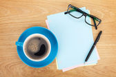 Blank lwith coffee, office supplies and glasses — Stock Photo