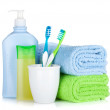 Toothbrushes, cosmetics bottles and towel — Stock Photo
