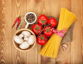 Pasta, tomatoes, mushrooms and spices — Stock Photo
