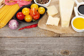 Parmesan cheese, pasta, tomatoes, vinegar, olive oil, herbs and spices — Stock Photo