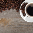 Coffee cup and beans on wooden table — Stock Photo #45807697