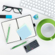 Green coffee cup and office supplies — Stock Photo #45807815