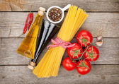 Pasta, tomatoes, condiments and spices — Stock Photo