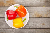 Colorful bell peppers on plate — Stock Photo