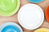 Colorful plates and saucers — Stock Photo