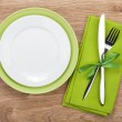 Fork with knife, blank plates and napkin — Stock Photo #46238679