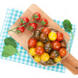 Colorful cherry tomatoes on cutting board — Stock Photo