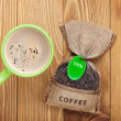 Coffee cup and small bag with beans — Stock Photo #46238823