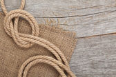Ship rope on wooden texture background — Stock Photo