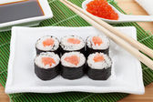 Sushi set, chopsticks, red caviar and soy sauce — Stock Photo