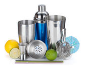 Cocktail shaker, strainer, measuring cup, drinking straws and citruses — Stock Photo