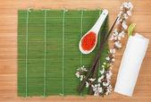 Red caviar, sakura branch and chopsticks — Stock Photo