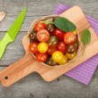 Colorful cherry tomatoes on wooden table — Stock Photo #46904717