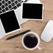 Blank photo frames over office table — Stock Photo #47311777