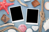 Travel photo frames on blue wooden texture — Stock Photo