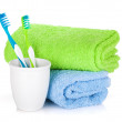 Two colorful toothbrushes and towels — Stock Photo #47762499