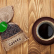 Coffee cup and small bag with beans — Stock Photo #47762601
