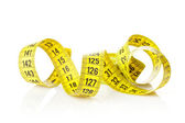 Yellow measure tape — Stock Photo