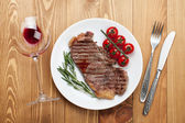 Sirloin steak with rosemary and cherry tomatoes on a plate — Stockfoto