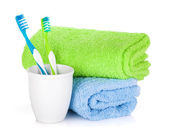 Two colorful toothbrushes and towels — Stock Photo