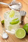 Classic margarita cocktail with salty rim on wooden table — Stock Photo