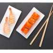 Постер, плакат: Sushi maki and shrimp sushi on black stone