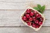 Ripe cherries on wooden table — Stock Photo