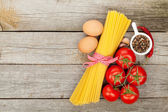 Pasta, tomatoes, eggs and spices — Stock Photo