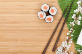 Sushi set, chopsticks and sakura branch — Stock Photo