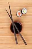 Maki sushi, chopsticks and soy sauce — Photo