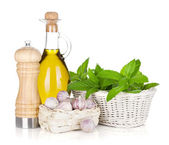 Fresh herbs, olive oil and pepper shaker — Stock Photo
